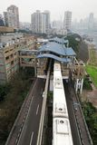 Light Rail Train Station and Train. The light rail train station is by the Yangze River.There are two light rail tracks under building dome in the train station Stock Photo