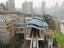 Light Rail Train Station. The light rail train station is by the Yangze River.There are two light rail tracks under building dome in the train station without Stock Image