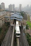Light Rail Train Station and Train. The light rail train station is by the Yangze River.There are two light rail tracks under building dome in the train station Stock Image