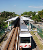Light rail transit for Kuala Lumpur. Mass transport system for City of Kuala Lumpur showing  train leaving a station Stock Photography
