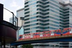 Light railway through city. Docklands light railway running through Canary Wharf Stock Photography