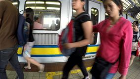 Light railway transit LRT leaving the train station, people standing. Manila, Philippines - July 9, 2017: Light railway transit LRT leaving the train station stock video