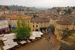Light rain in Autumn at the main market square of the beautiful Saint Emilion town