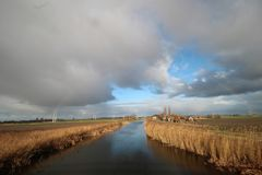 Light rainbow above the source of the river Rotte at the Wilde Veenen polder in Moerkapelle the Netherlands. Light rainbow above the source of the river Rotte stock photography