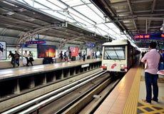 Light Rapid Transit Train. Kuala Lumpur,Malaysia - February 16, 2014 : The passengers waiting the Light Rapid Transit train approaching the station Masjid Jamek Royalty Free Stock Photo