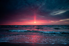 Light Ray Sunset. Very special light ray appearing from sun through skies Royalty Free Stock Photo
