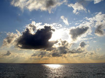 Light rays. The sun shining through the clouds Royalty Free Stock Images