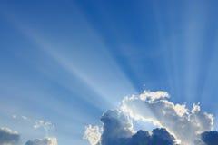 Light rays on blue sky background Royalty Free Stock Photos