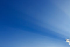 Light rays on blue sky background Stock Image