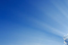 Light rays on blue sky background Royalty Free Stock Photos