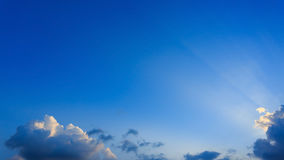 Light rays on blue sky background Stock Images