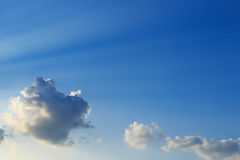 Light rays on blue sky background Royalty Free Stock Photography