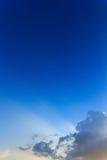 Light rays on blue sky background Stock Photo
