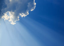 Light rays on blue sky Royalty Free Stock Photo