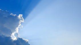 Light rays on blue sky Stock Photography