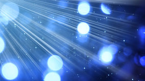 Light rays and bokeh circles blue background Royalty Free Stock Images
