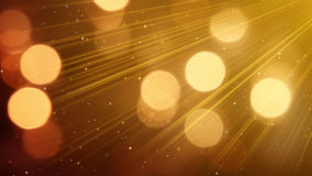 Light rays and bokeh circles golden background Stock Photography