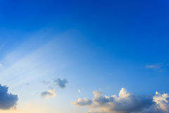 Light rays on clear blue sky Stock Photography