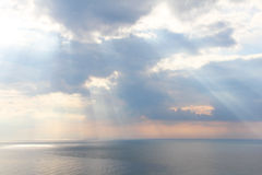 Light rays through the clouds over sea Stock Image