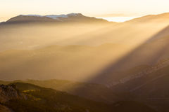 Light rays. Coming from the sunset in the eastern Pyrenees, Spain Royalty Free Stock Photos