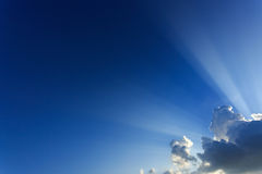 Light rays explosion on blue sky with cloud Stock Images