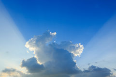 Light rays explosion on clear blue sky Royalty Free Stock Photo