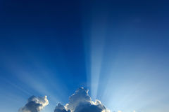 Light rays explosion on clear blue sky Royalty Free Stock Images