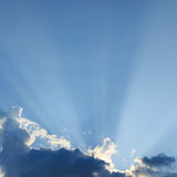 Light rays explosion on clear blue sky Stock Images