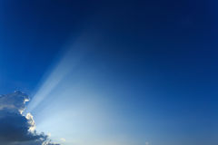Light rays explosion on clear blue sky Stock Photography
