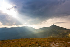 Light rays over mountains Stock Images