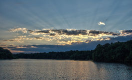 Light Rays Over The Lake At Sunset Stock Photo