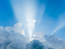 Light rays shine. Through clouds Royalty Free Stock Image