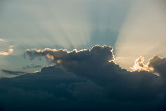 Light rays shine through the clouds Stock Photo