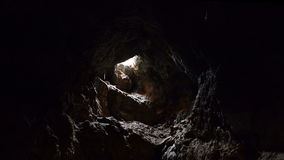 Light Rays Shine inside of Lava Tube Cave - 4K stock footage