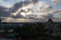 Light of rays shining through dark clouds Stock Image
