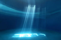 Light rays shining through water Stock Images