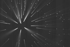 Light rays through small holes in a dark space stock photo