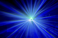 Light rays from a stage light show. Multicoloured light beams from a high up disco stage light Stock Photo
