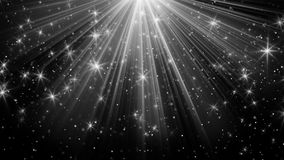 Light rays and stars on black background Royalty Free Stock Image