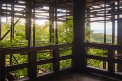 Light rays at the structure of the veranda of the famous Kiyomizu-dera Temple, Kyoto, Japan. Light shines through the wooden structure of the main temple veranda royalty free stock photos