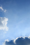 Light rays of sun on clear blue sky Stock Photos