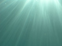 Light rays through the water Stock Photos
