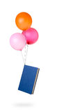 Light reading concept - book carried by balloons Stock Photos