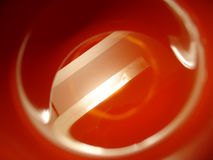 Light in red. Abstract reflection in a cup of tea Stock Photography