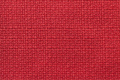 Light red background from a textile material. Fabric with natural texture. Backdrop. Royalty Free Stock Images