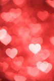 Light red heart bokeh background photo, abstract holiday backdrop Stock Images
