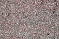 Light red rough stucco background. In the daytime Royalty Free Stock Images
