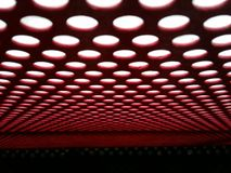 Light red and white. Light over a grate Royalty Free Stock Image