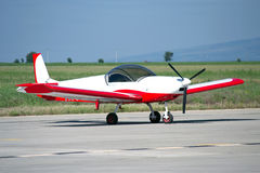 Light Red/white Painted Private Aircraft Royalty Free Stock Photography