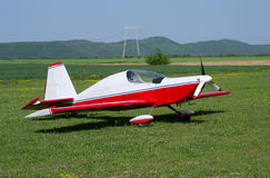 Light red/white painted private aircraft Royalty Free Stock Images